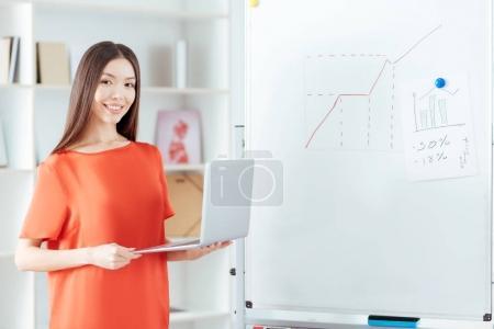 Brunette positive woman fulfilling task
