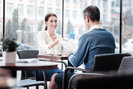Pretty female person giving her CV