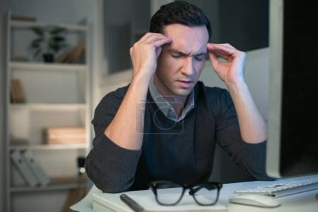 Handsome male programmer concentrating on idea
