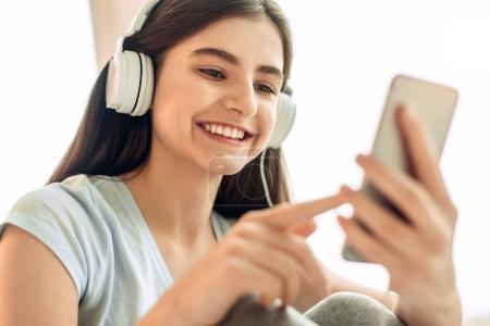 Close up of teenage girl choosing music tracks