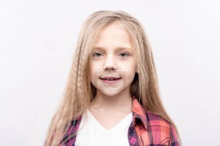 Portrait of fair-haired little girl smiling