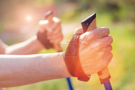 Close up of old woman holding crutches
