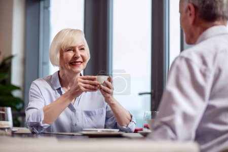 Attractive mature woman drinking coffee