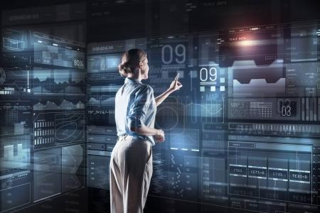 Calm programmer touching the screen while starting her working day