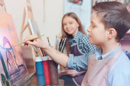 Cheerful kids painting together
