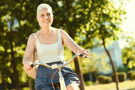 Happy excited woman riding a bike