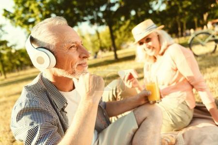 Positive aged man wearing headphones