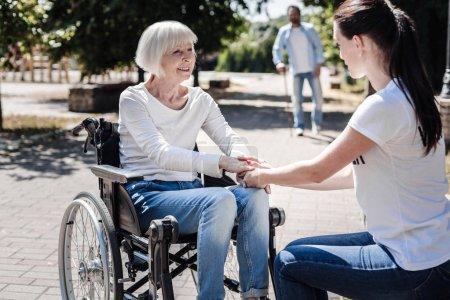 Photo for I appreciate this. Joyful nice aged woman smiling and looking at the volunteer while being thankful for her support - Royalty Free Image