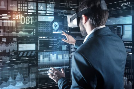 Calm programmer working and using virtual reality device