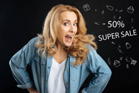 Excited woman feeling happy while going shopping at discount prices
