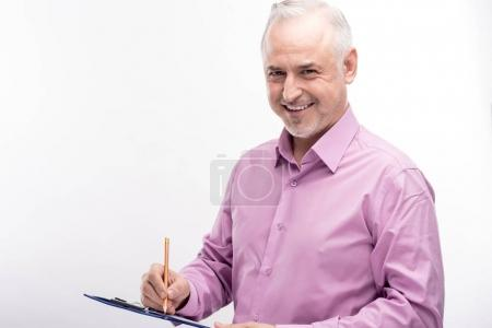 Pleasant grey-haired man filling in a form on sheet holder