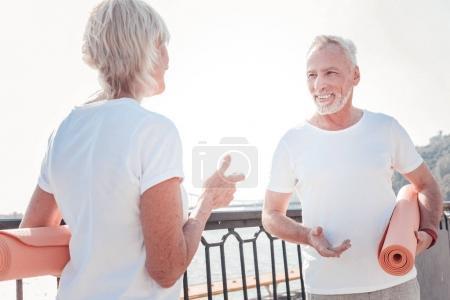 Some advices. Talkative senior pleasant couple pre...