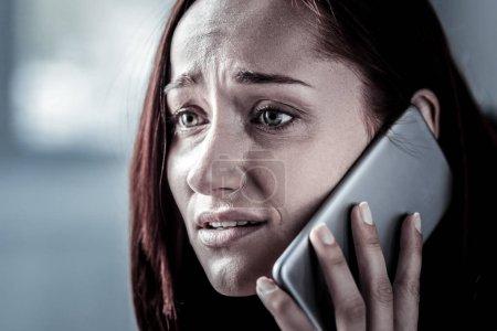 Sad worried woman calling and having stress.