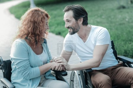 Photo for Listen to me. Attentive female person sitting on her wheelchair and looking forward while having health problems - Royalty Free Image