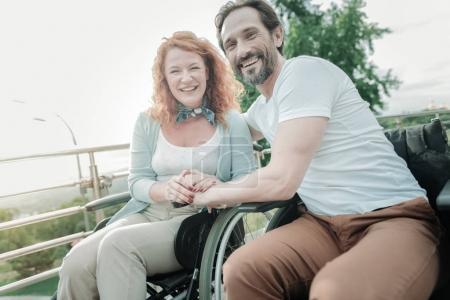 Joyful woman sitting near her man