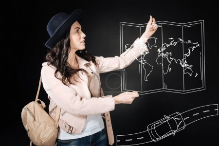 Clever experienced tourist holding a map while travelling