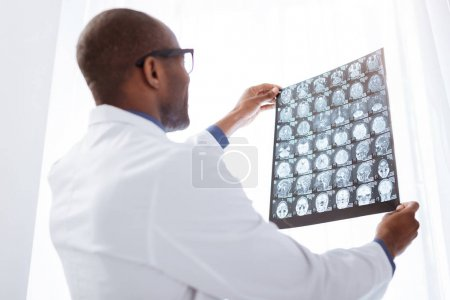 Budding male doctor estimating brain imaging