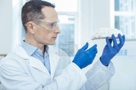 Professional neurosurgeon detecting brain tumor risk