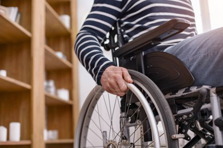 Detailed picture of wheelchair that being on the foreground