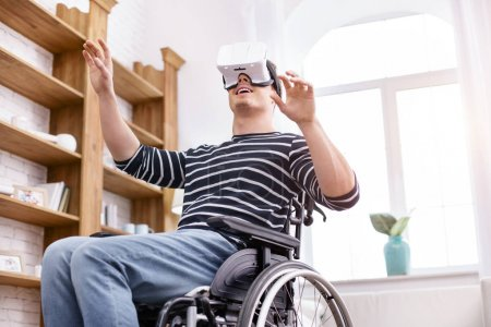 Happy disabled man being glad of his gadget