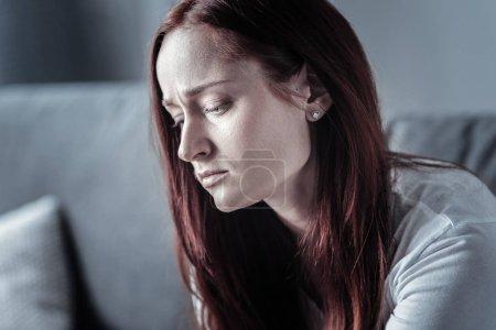 Upset sad woman having depression