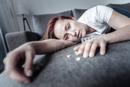 Exhausted tired woman overwhelming by depression