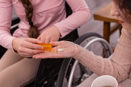 Young handicapped girl supplying woman with drugs