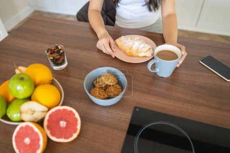 Photo for Cropped photo of Asian girl having breakfast - Royalty Free Image