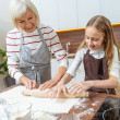Senior woman giving her grandchild the cooking ins...
