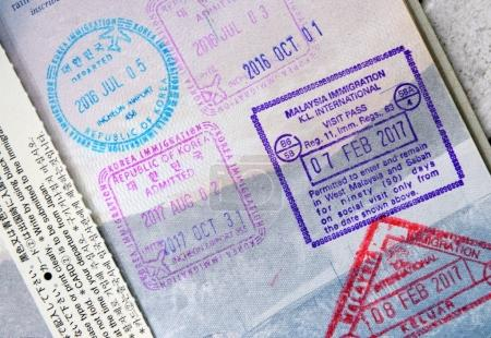 Closeup of Immigration stamps in Passport showing travel concept