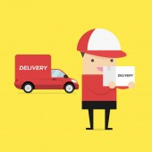 Caucasian delivery courier holding box on the background of truck. Delivery courier carrying cardboard box. Delivery courier with box in hands.