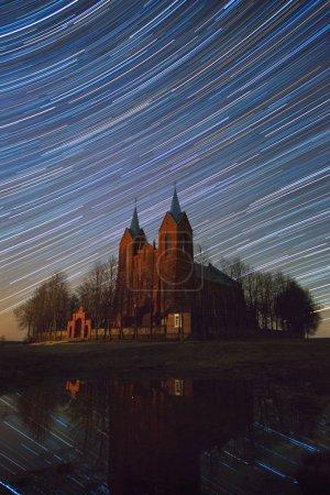 Old church under star trails