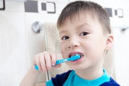 Boy brushing teeth, child dental care, oral hygiene concept, boy portrait in bathroom with tooth brush,healthy lifestyle