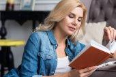 Pretty blond lady reading book