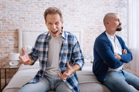 Inflamed man screaming loudly at home