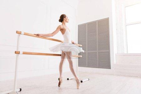 Adorable ballerina looking in the window