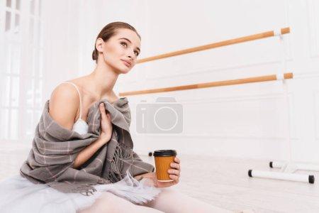 Portrait of pretty girl posing in ballet studio