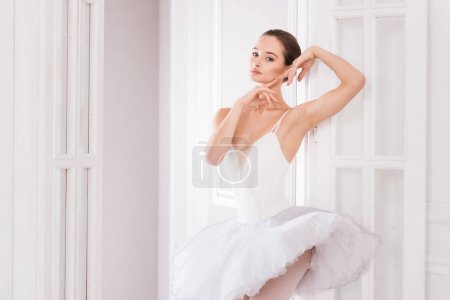 Graceful ballerina touching her face