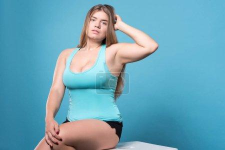 Pretty posing sitting chubby lady