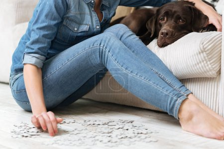 woman spending her time doing puzzles