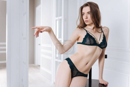Nice woman pointing sideways