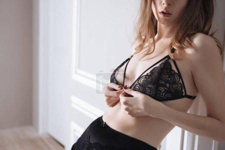 black lace bra wearing on female