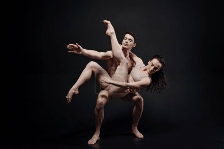 Harmonious dance couple. Masterful powerful young ...