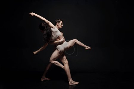 Inventive young dance couple taking part in the art performance