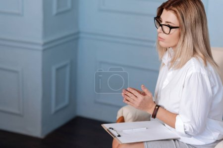 Professional woman working in a light room
