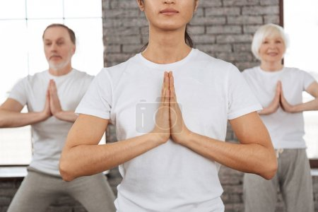 Close up of pressed hands while meditation