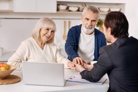 Real estate agent meeting with elderly couple