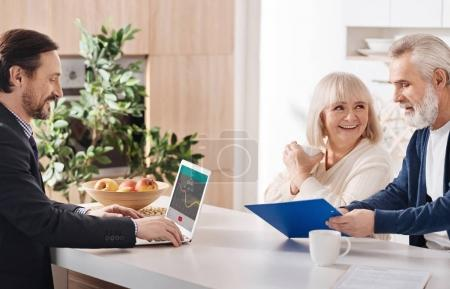 Professional lawyer working with aged couple