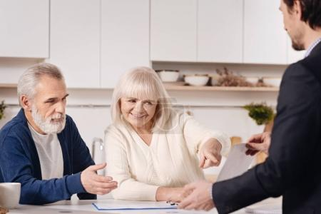 agent selling the house to aged couple