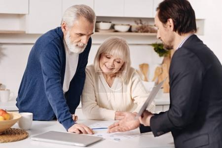 agent recommending the house to elderly couple